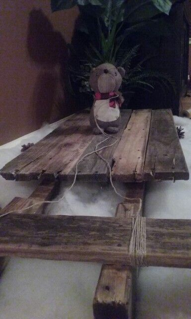 Sled we made out of pallet wood for Christmas, and our driver Jeremy the squirrel!