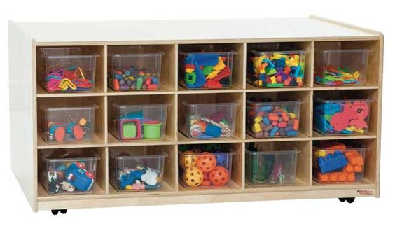WOOD DESIGNS \\ 30 Tray Tot-Size Mobile Island with Clear Trays.    GREENGUARD® Gold certified. The (30) Tray Tot-Size Mobile Island includes fifteen clear trays on each side for easy & convenient storage of manipulatives, art materials, and many additional needs on either side. Also can be used as a convenient room divider. Made with 100% Healthy Kids™ Plywood and our exclusive Tuff-Gloss™ UV finish. Fully assembled. On casters for easy mobility.