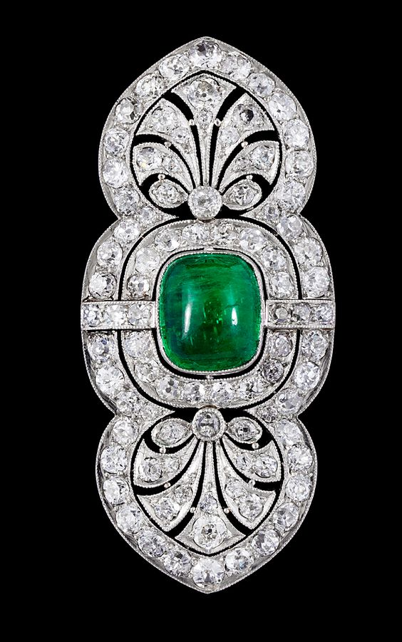 A cabochon cut emerald and diamond brooch, 1930's.  Platinum and 14k gold. L. 5…