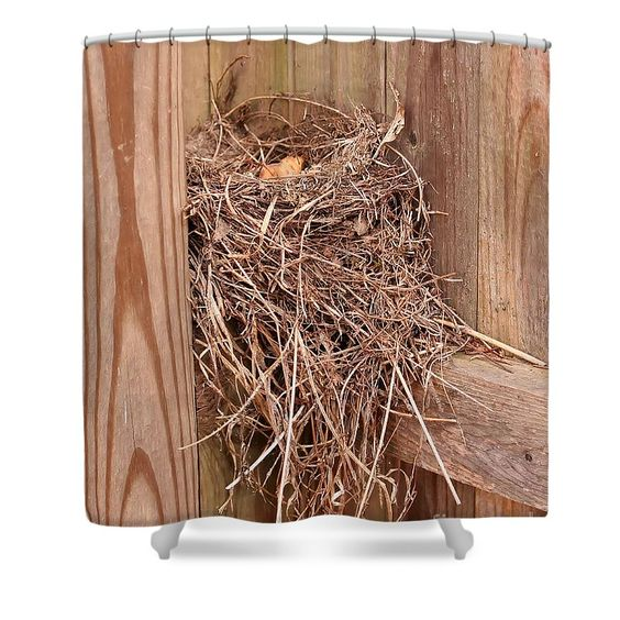 An abandoned bird nest on a wooden fence nature shower Nature inspired shower curtains