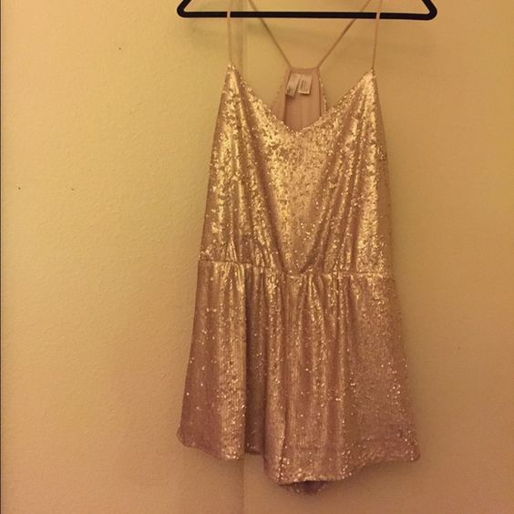 Forever 21 Light Pink Sequin Romper Worn once, romper is heavy doesn't have a zipper. Perfect for parties! It seems that all sequins are in tact but possible that some may have fallen out though no visible signs. In good condition! Last picture is a similar style for reference Forever 21 Dresses Mini
