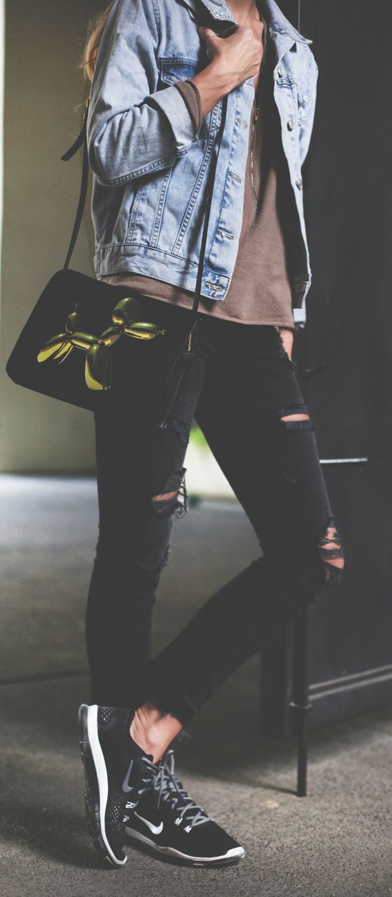 Mary Seng is wearing a brown top from The Kooples, distressed black jeans from Current Elliott, denim jacket from TopShop, black sneakers from Nike and the bag is from H&M