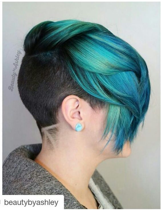 Turquoise Teal green dyed hair with shaved sides and back