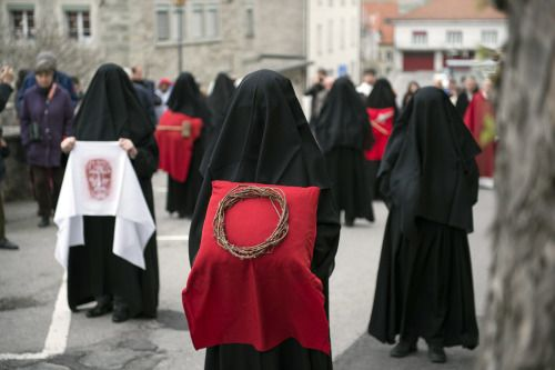 "speciesbarocus: "" Veiled women known as Les Pleureuses, or the mourning ones, commemorate the Passion and Crucifixion of Jesus in a procession in Romont, Switzerland, Friday, 18 April 2014. > Photo by Gian Ehrenzeller. [x] """