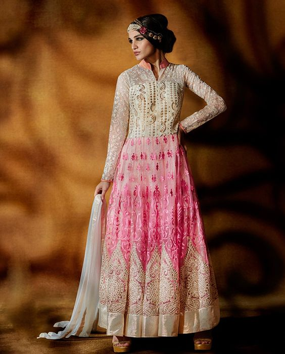 Baby Pink And Off White Anarkali Suit   1. Net embroidery, textured net and tissue, this anarkali Suit is blended in the colors of baby pink and off white. The embroidered net kali with textured and embroidered net on the yoke along with the tissue laces on the panel, sleeves and collar gives a phenomenal glist. 2. Comes with matching bottom and dupatta3. Sizes available: M, L, XL, XXL