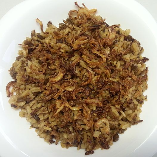 Madardara is like mejadara but cooked and presented differently. We don't pass the  lentils in the mill they remain whole, the taste is different too, with the sweet fried onions on top.