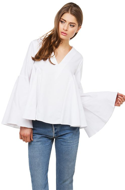 The bell sleeve top in off white features a deep v for Bell bottom sleeve shirt
