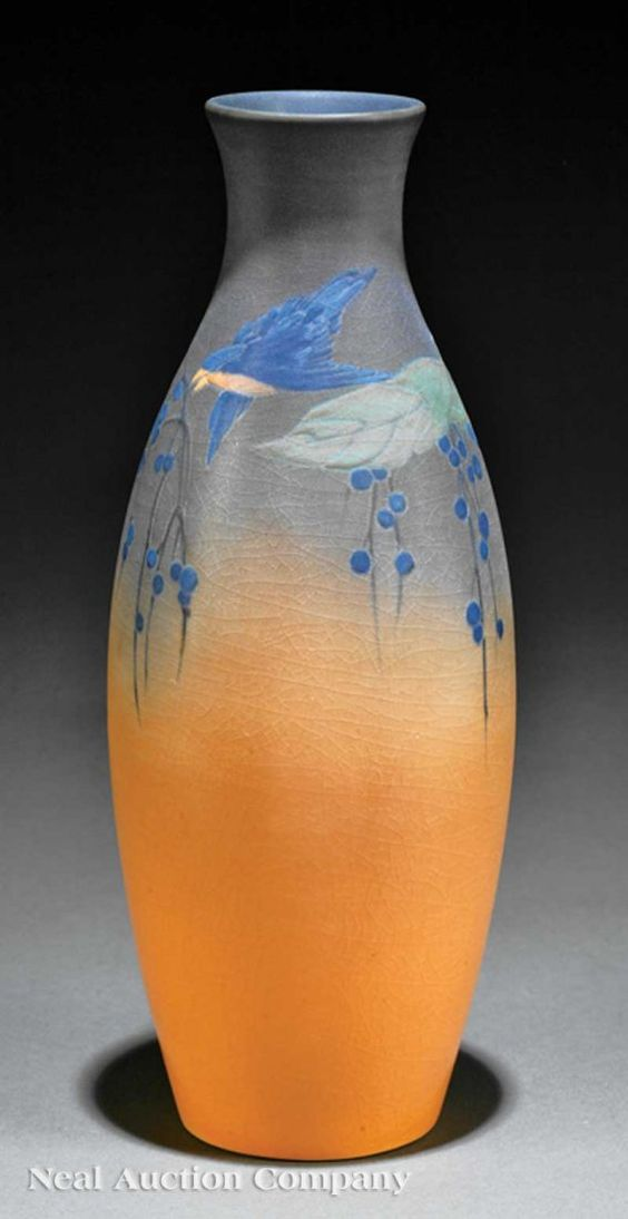 A Rookwood Art Pottery Vase, 1917, decorated by Lorinda Epply, with a design of a blue bird and berry branches, vellum glaze, base marked with Rookwood cipher, decorator's mark, shape no. 2188 and datemark XVII, height 11 in