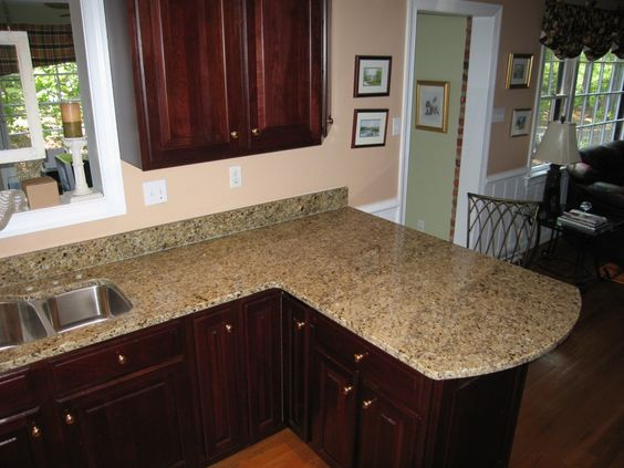 darker wood cabinets with our venetian gold granite countertops in ...