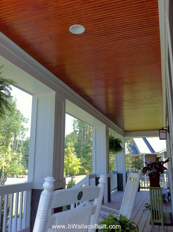 Beautiful front porch with stained bead board ceiling for Stained front porch