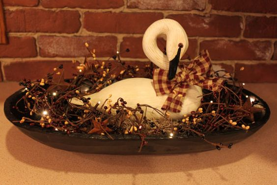 Wooden bowl centerpiece with white swan pip berries and