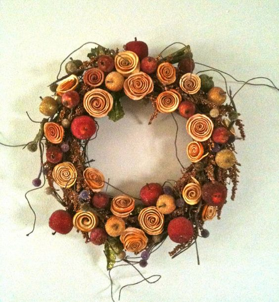 This a gorgeous wreath with handmade flowers orange peels and other organics produts..This would look great on inside your home or office.