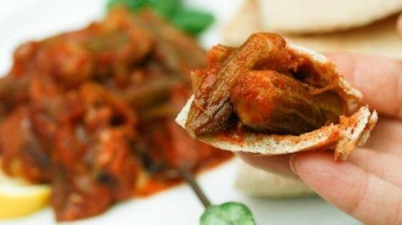 lamb meat and okra stew (بامية بلحمة الضاني ) , cooked okra in garlic tomato sauce and lamb meat , served with white rice or shami bread.