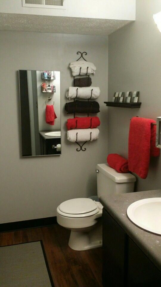 Red Black Bathroom Wine Rack Used As A Towel Rack