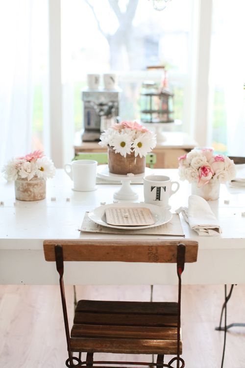 white farm table, black and tan chairs