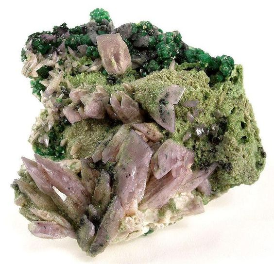 Prehnite (Manganoan), lavendar color, with Grossular Garnet, Jeffrey mine, Asbestos, Estrie, Quebec, Canada. Size 7.0 x 6.9 x 3.4 cm