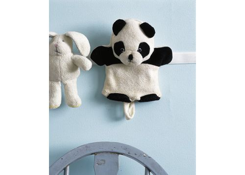 Attach a Velcro strip to the wall to store soft toys.