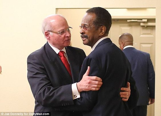 Instrumental: Larry Graham, of Sly and the Family Stone bassist who is credited with introducing Prince to the Jehovah's Witness faith, hugs congregation elder and coordinator James Lundstrom at the Kingdom Hall of Jehovah Witness in Minneapolis, where Prince was a congregation member in his last years.