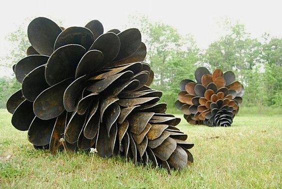 Old Shovel garden sculptures...... that is a lot of shovel heads!: