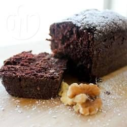 This is a moist fudgy type cake. Sweet but not extremely sweet and makes good use of courgette! You can ice it with chocolate icing or cream cheese icing.