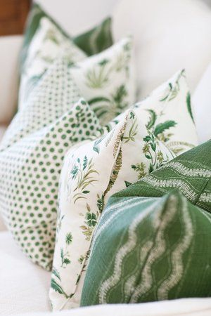 Home decor ideas and Spring interior design inspiration! Green pillows look fresh and gorgeous on a white sofa.