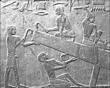 Egyptian craftsmen shaping a wooden ship, the form apparently inherited from their reed boats.