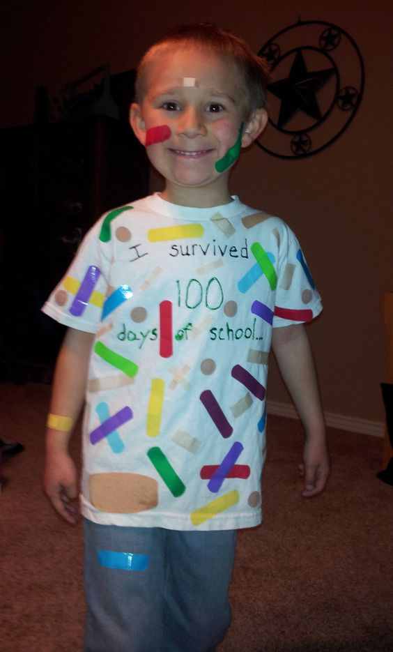 """To celebrate the """"100th Day of School"""" students were supposed to wear 100 of something. So going with the theme of """"I survived 100 days..."""" we chose bandaids. We put 95 bandaids on the t-shirt and he wore 5 on his body. On the back we added """"So did Mrs.Major!!"""" (his teacher, God bless her)"""