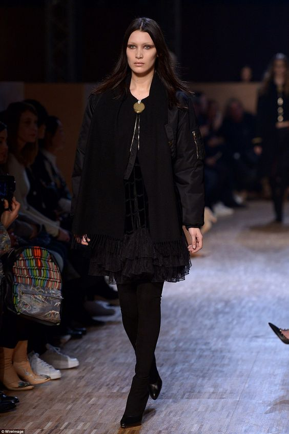 Gothic chic: The supermodel's pale complexion was exaggerated by smeared dark eye make-up ...
