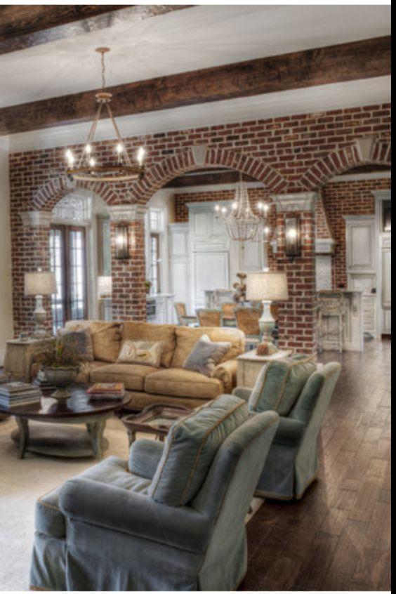 Bricks exposed brick and beams on pinterest for Wooden arch designs in living room