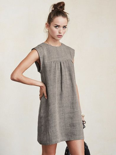 Just something easy for those warmer days. All you have to do is throw it on and roll out (hair flip). The Collins Dress is a medium weight linen mini dress with cap sleeves, side pockets and pleated seaming along the bust. The fit is loose and comfortable, keyhole back with hook/eye closure.  Made from surplus linen blend.