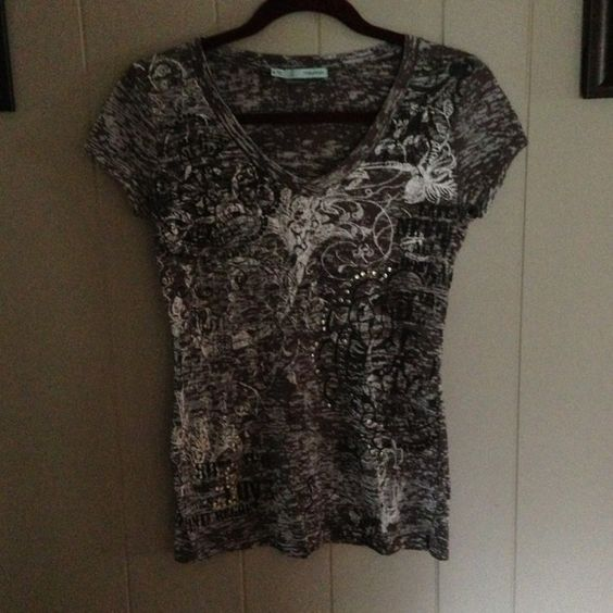SALEShort sleeved burnout top A Maurice's brand size Medium top. Browns, greys, cream colors. It has studded detail on it. Beautiful preloved top in good condition. It is a burnout top as well. Tops