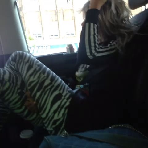 Lou jamming out in the car.