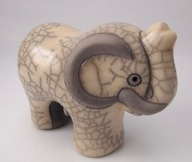 Raku Pottery Hand Painted Elephant - each piece is handmade before being fired at a very high temperature. A Fair Trade card explaining the background of Raku Pottery comes with your piece.