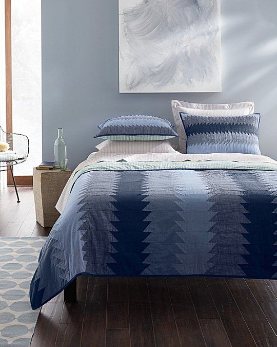 A Modern Take On The Traditional Sawtooth Quilt Hand Stitched Stripes In Repeating Shades Of Chambray And Allover Quilted Striped Quilt Bedding And Bath Sham