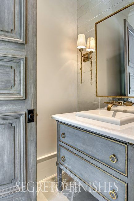 Magnificent blue grey paint finish on bathroom vanity and door by Segreto Finishes. Come check out Antique Vintage Style Bathroom Vanity Inspiration! #bathroomdesign #bathroomvanity #classicstyle #traditionaldecor #interiordesignideas