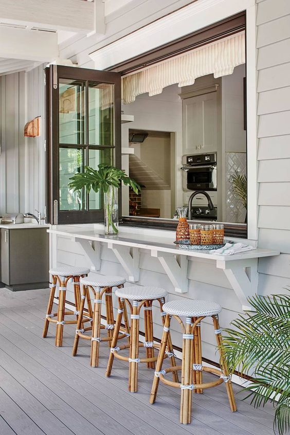 kitchen opening up to back porch dining area with folding glass windows. great for everyday use. #harbor17