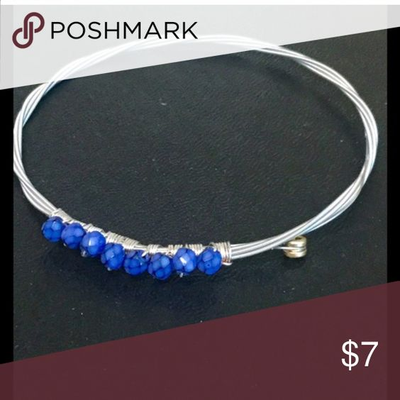 Sterling silver blue beaded bangle. Pretty sterling silver flexible bangle. I am Re-Poshing this bracelet because sadly it doesn't fit my mothers wrist. Am asking what I paid for it. Am not even getting back the shipping I paid so price is firm. Jewelry Bracelets