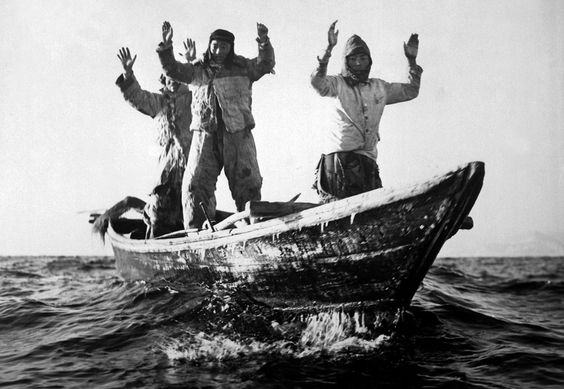 Three Korean Communists in a fishing boat are captured by the USS Manchester off the coast of Korea. May 10, 1951