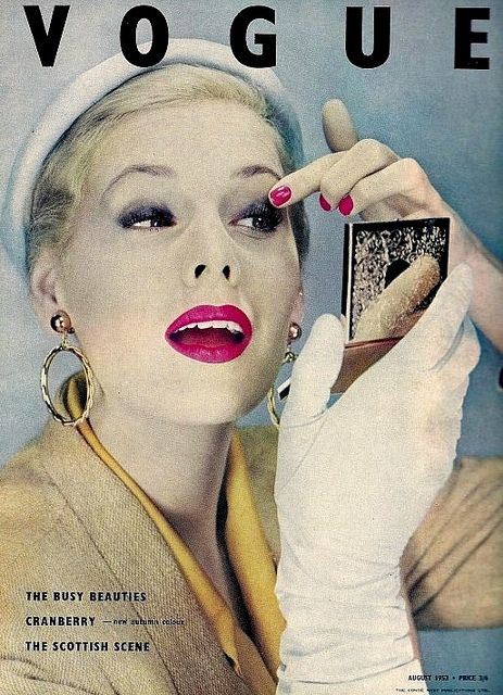 The all important last minute compact check. Vogue 1950s: