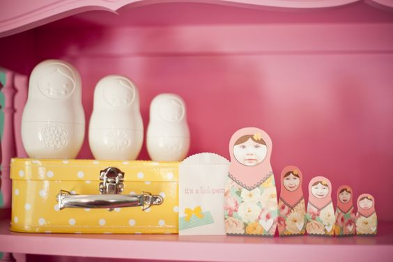 the invite matyoshka dolls i made in photoshop with nessa's faces on it starting with newborn through 1st year