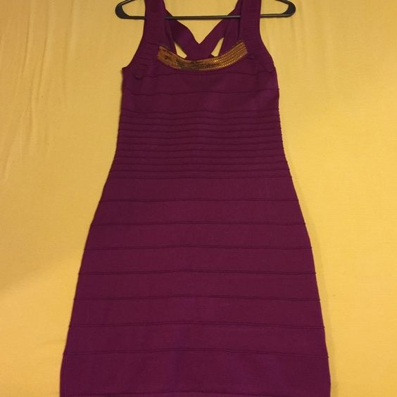 Maroon dress with gold sequins lining the neck Maroon dress with crossing straps in the back and gold sequins lining the neck. Never worn. Just does not fit correctly like I hoped. Make any offer!!!  Pink Rose Dresses
