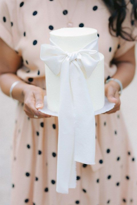 Elegant buttercream wedding cake tied with a hand-dyed silk ribbon | Sugar Plum Bakes