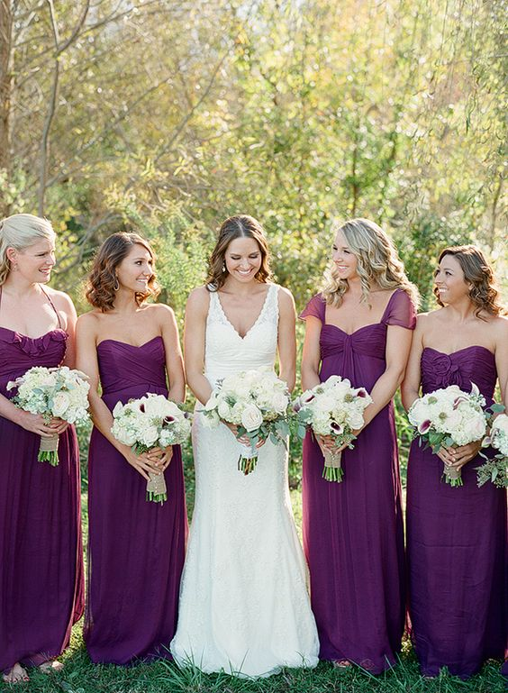 Purple bridesmaids dresses and bouquets... elegant