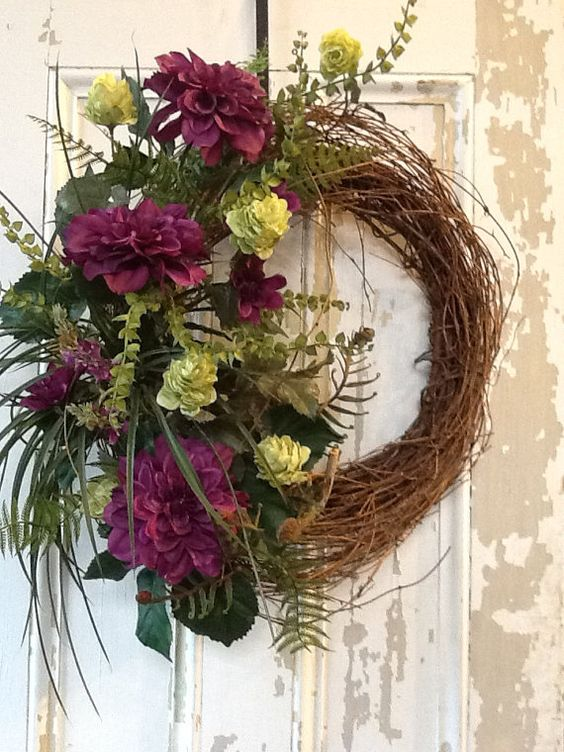 Grapevine wreath with magenta/purple peony, bright green hops, ferns, grass and more.