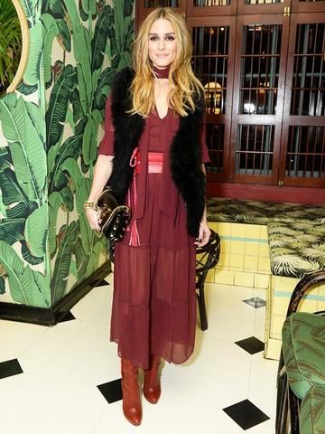 Olivia Palermo in a burgundy belted dress