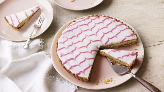 This classic Bakewell tart is topped with feathered icing to give an impressive finish.  For this recipe you will need a 23cm/9in fluted flan tin, baking beans, piping bag fitted with small plain nozzle and a few cocktail sticks.