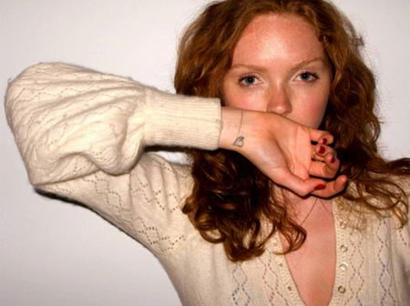 Scott Campbell Tattoos Lily Cole Right arm heart tattoo