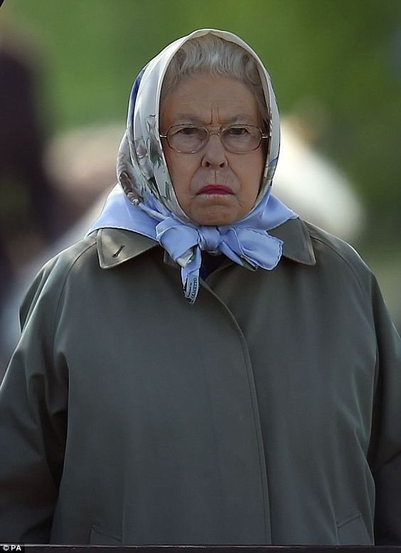 One is not amused: The Queen looked slightly disgruntled in an unguarded moment
