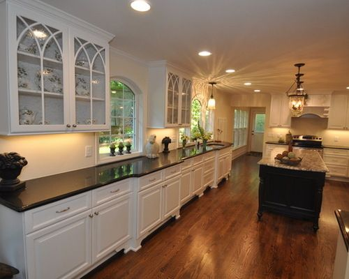 White cabinetry hardwood floors black quartz countertops for Stellar night quartz price