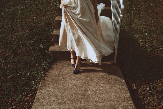 """By hiding the bride's face, photographer Nessa K says she offers a """"bit of mystery"""" in this photo—likening it to that feeling the bride and groom experience right before the first look. Photo © Nessa K"""